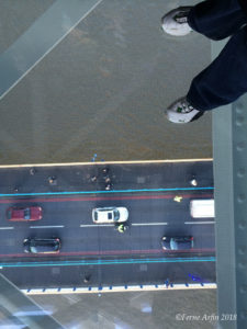 Standing on the glass floor of the Tower Bridge Walkway