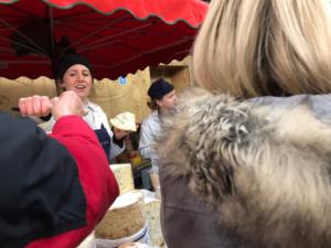 Sampling cheeses, borough market, cheese seller, stilton, england, london