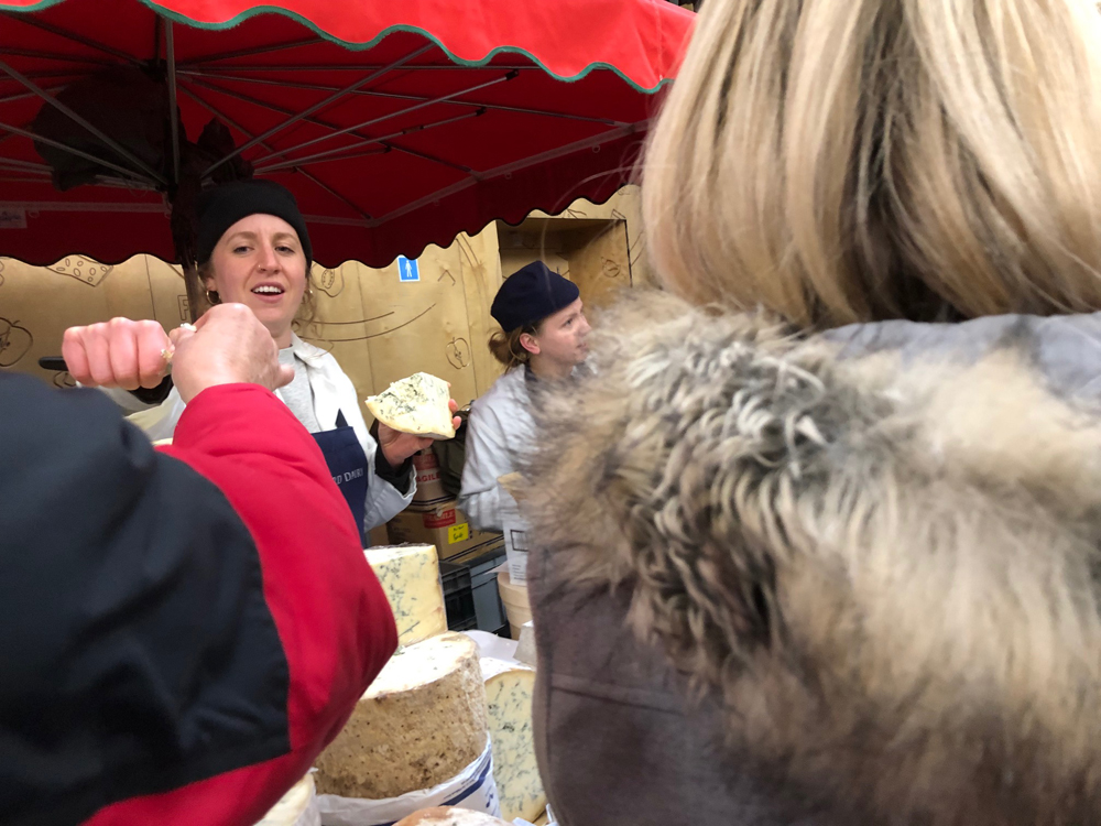 Sampling cheeses, borough market, cheese seller, stilton, england, london