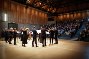 chamber orchestra in the Britten Studio with audience.