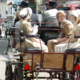 4 girls in bonnets and two drives in top hats during carriage ride during Jane Austen Alton Regency Day