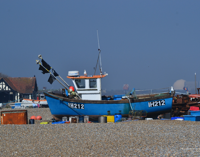 Blue working fishing boats on Aldeburgh Beach