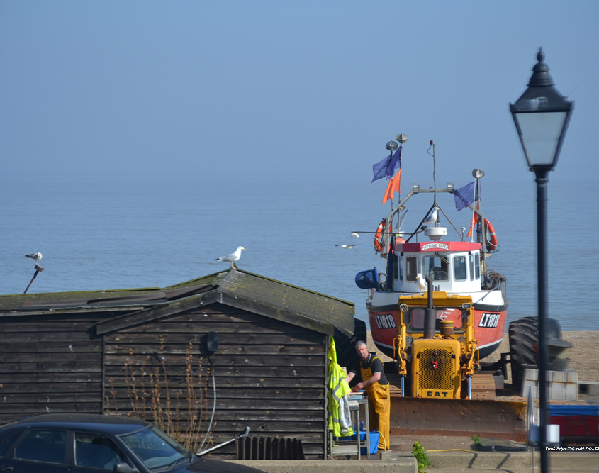 fishing boat and fisherman on Aldeburgh beach