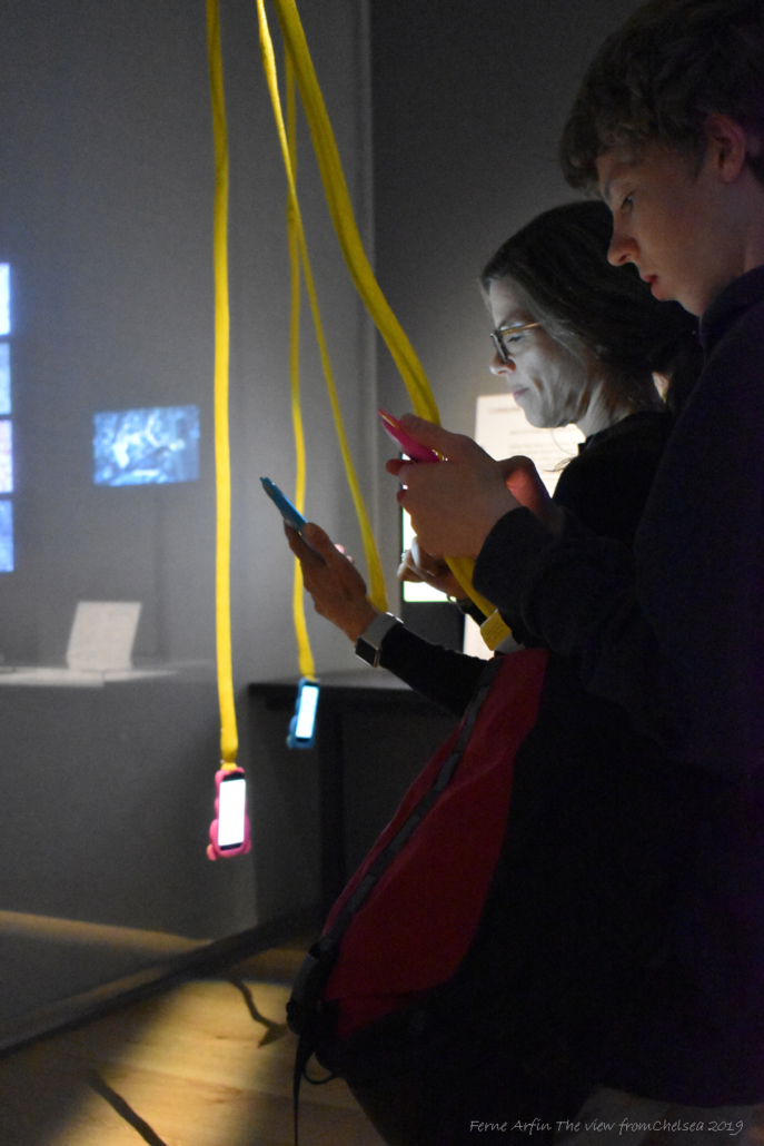 Museum goers trying videogames on phones at the V&A Dundee