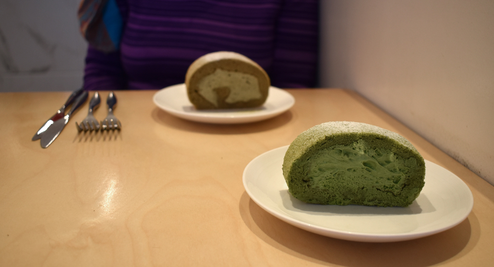 green roll cake with green filling and brown roll cake with tan filling