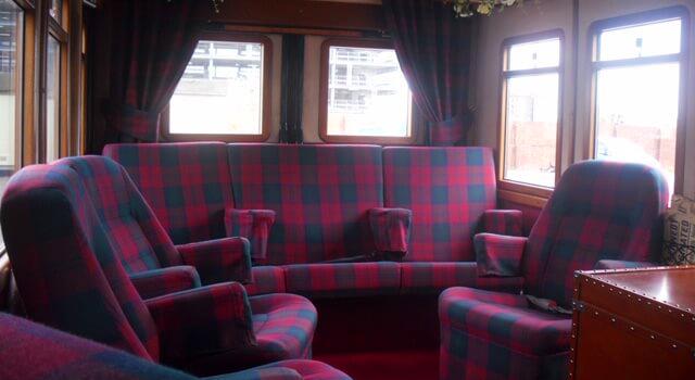 Interior of vintage bus upholstered tartan seats