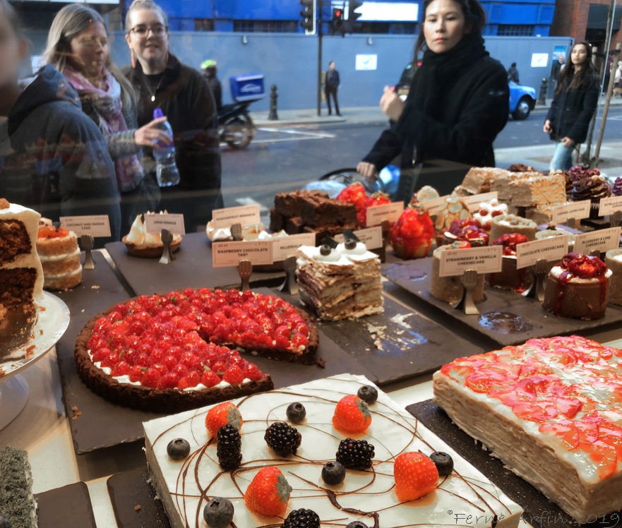 People looking through a window at cakes at L'Eto on the King's Road #london_cake_shops, #kings-road-cakes, #england #london#foodie #sweet-treats #where-to-eat-cake