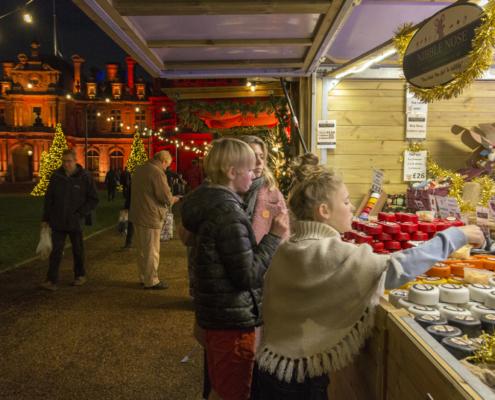 Children at a christmas fair stall. #christmasfair, #waddesdon#holidays#christmasmarket#holidayfair