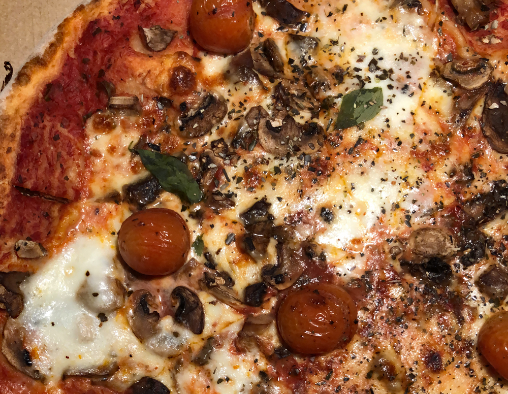 Pizza with mushrooms and cherry tomatoes