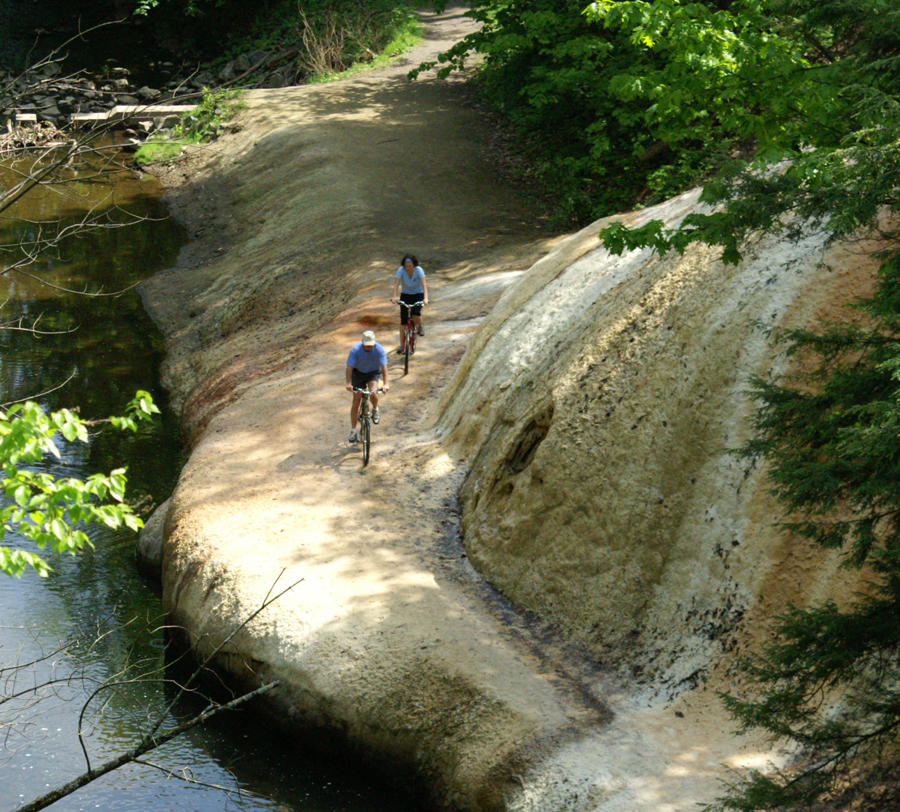 cyclists pass giant mineral formation on Saratoga Springs weekend escape