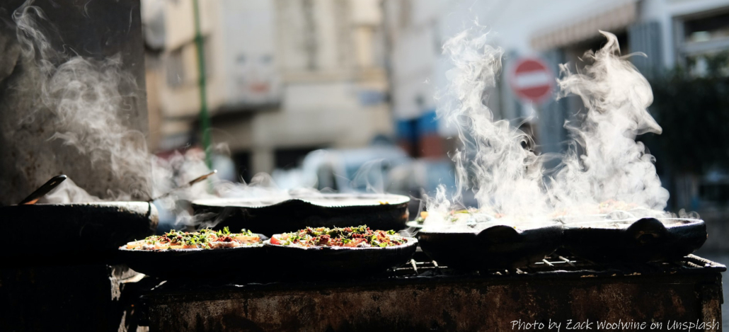 cooking in Morocco, tagines at a street market